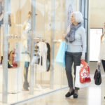 42307374 - mother and adult daughter in shopping mall together
